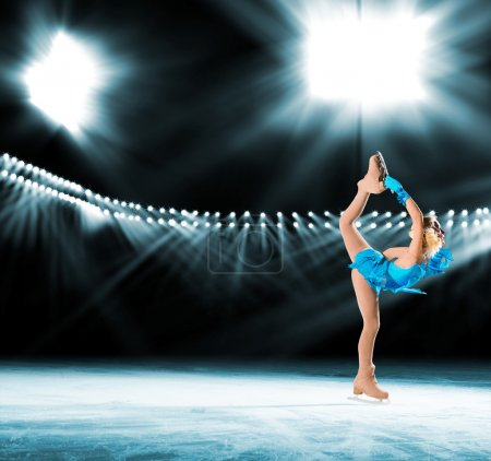 Photo for Young skater performs on the ice in the background lights lighting - Royalty Free Image