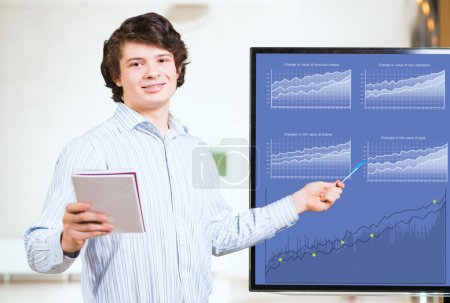 young business man shows on the monitor charts