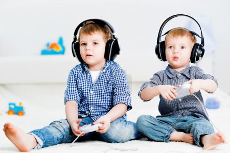 Photo for Two brothers wireless headphones play on your gaming console - Royalty Free Image