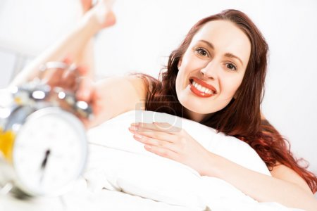 woman turns off the alarm