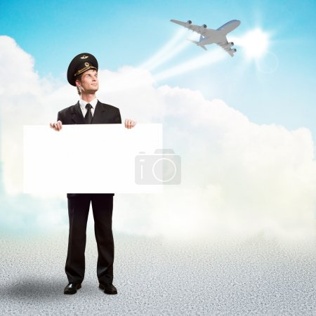 Pilot in the form of holding an empty billboard
