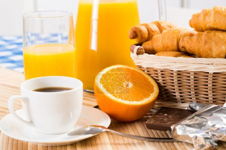 Photo for Continental breakfast: coffee, orange, croissant and juice - Royalty Free Image