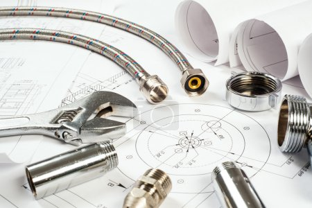 Photo for Plumbing and drawings are on the desktop, workspace engineer - Royalty Free Image