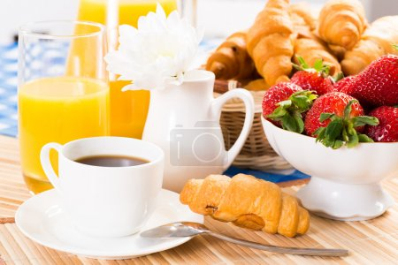 Photo for Continental breakfast: coffee, strawberry, croissant and juice - Royalty Free Image