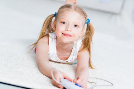 girl playing on a game console