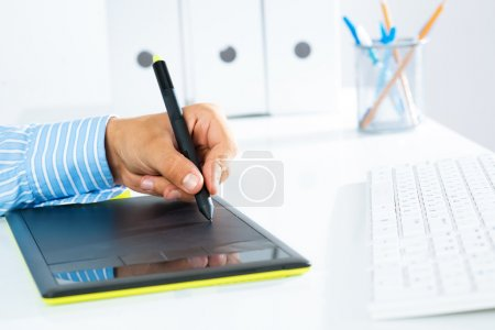 close-up of a man's hand with a pen stylus
