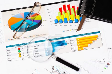 Photo for Diary, glasses, magnifying glass, and business documents with charts, business still life - Royalty Free Image