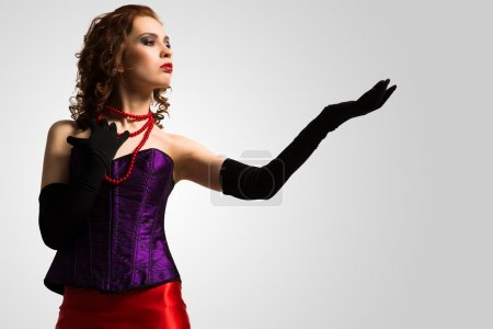 Woman in corset and red dress