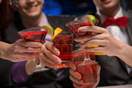 Photo for Close-up of hands with glasses, a toast, party with friends - Royalty Free Image