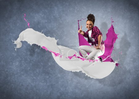female dancer with splashes of paint