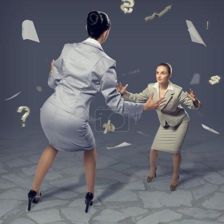 Businesswomen fighting as sumoists