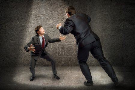 Two businessmen fighting as sumoists