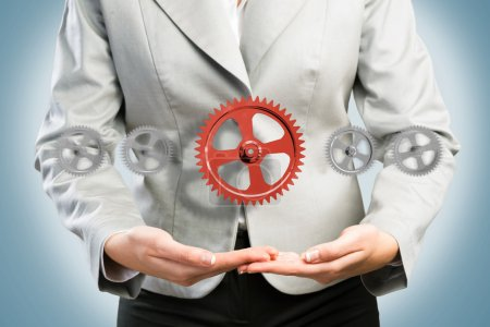 femme d'affaires peut contenir jusqu'à un mécanisme d'engrenages