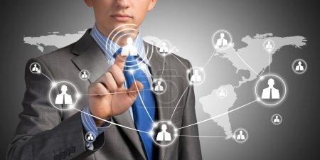 Businessman pushing social network