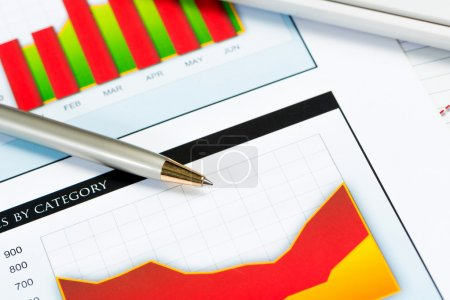 Photo for Close-up of pen and financial growth charts, workplace businessman - Royalty Free Image