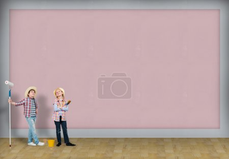 Photo for Image of a children finished painting the wall - Royalty Free Image