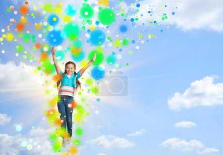 Photo for Girl jumping on a background of blue sky - Royalty Free Image