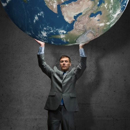 Businessman holding Earth planet