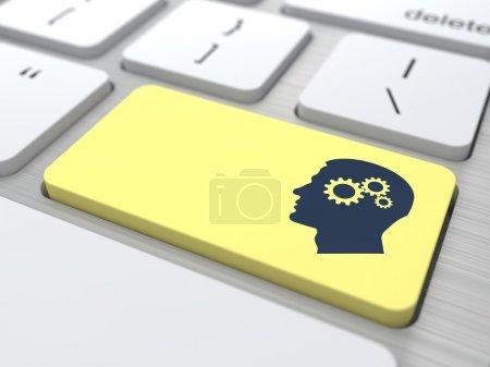 Photo pour Profil de tête avec un engrenage sur le bouton jaune de l'ordinateur. - image libre de droit