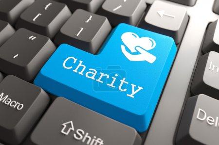 Photo pour Bouton bleu de la charité sur le clavier de l'ordinateur. concept social. - image libre de droit