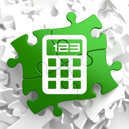 Calculator Icon on Green Puzzle.