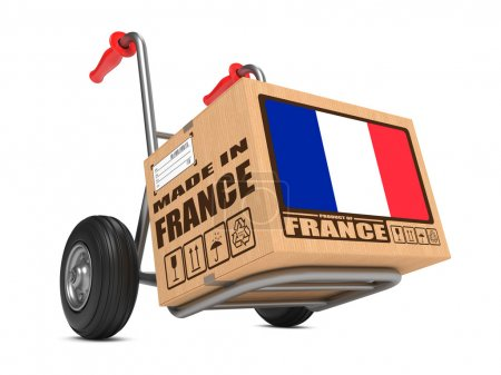 Photo for Cardboard Box with Flag of France and Made in France Slogan on Hand Truck White Background. Free Shipping Concept. - Royalty Free Image