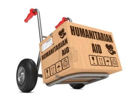 Photo pour Slogan de l'aide humanitaire sur carton box quant à fond de camion blanc. - image libre de droit
