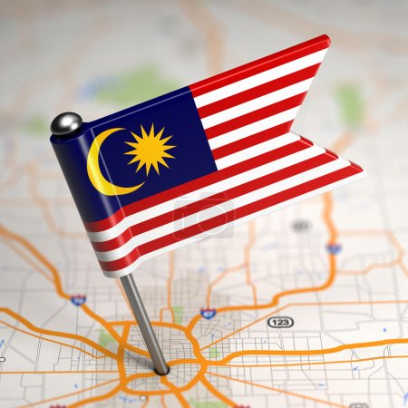 Malaysia Small Flag on a Map Background.