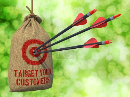 Photo for Target Your Customers - Three Arrows Hit in Red Target on a Hanging Sack on Green Bokeh Background. - Royalty Free Image