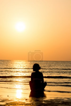 Single young woman at sunset.