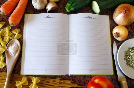 Photo for Top view of an empty recipe book surrounded of food ingredients and kitchen utensils - Royalty Free Image