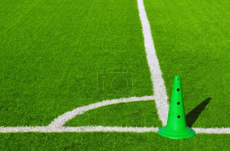 Photo for Detail of corner mark in a sports grass field with green plastic cone - Royalty Free Image