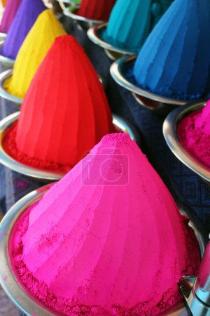 Piles and mounds of colorful dye powders for holi festival & oth