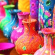 Colorful artistic pots or flower vases in vibrant ...