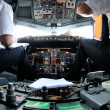 Preparing the flight plan in the aircraft cockpit...