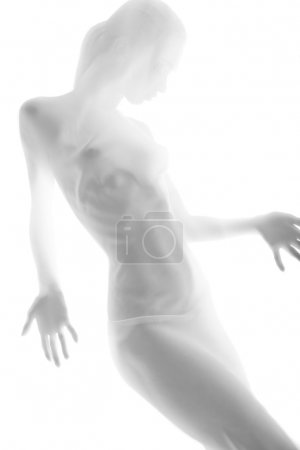 Beautiful naked woman through transparent fabric