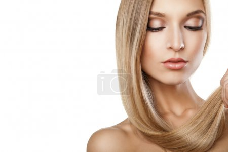 Woman with long straight blond hairs isolated