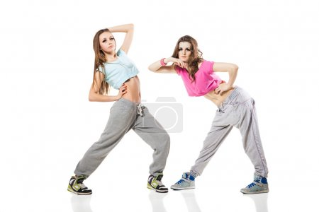 Cool looking two dancing women on gray background...