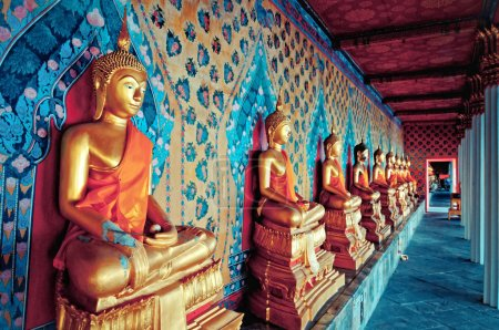 Gloden statues of Buddha in Wat Arun temple, Bangkok