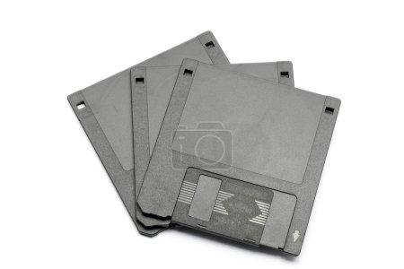 Photo pour Stockage de données sur disquette magnétique ordinateur appuyer sur fond blanc - image libre de droit