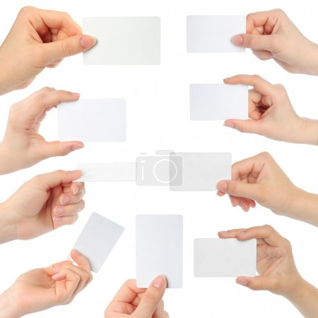 Hands hold business cards on white background...