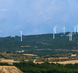 Panoramic image of wind turbines on the ridge of a...