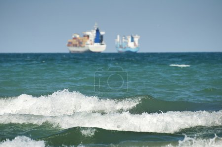 Commercial container ship on blue sky