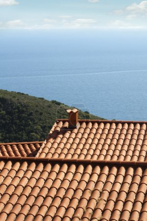 Tile roof of the house overlooking the sea
