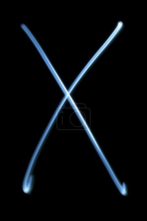 The letter X from neon light.
