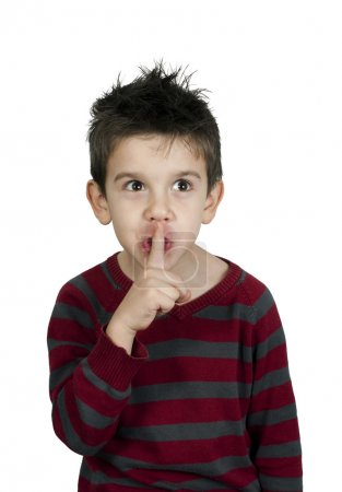 Little boy showing silence symbol...