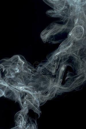 Photo pour Fumée sur fond noir. Tourbillons et art - image libre de droit
