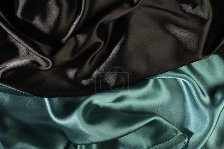Shiny black and green satin fabric