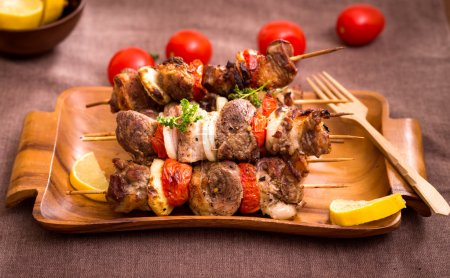 Photo for Barbecue meat with vegetables on skewers - Royalty Free Image