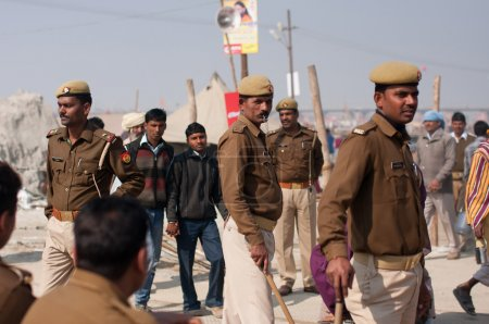 Indian policemen control of the situation at the biggest festival in the world